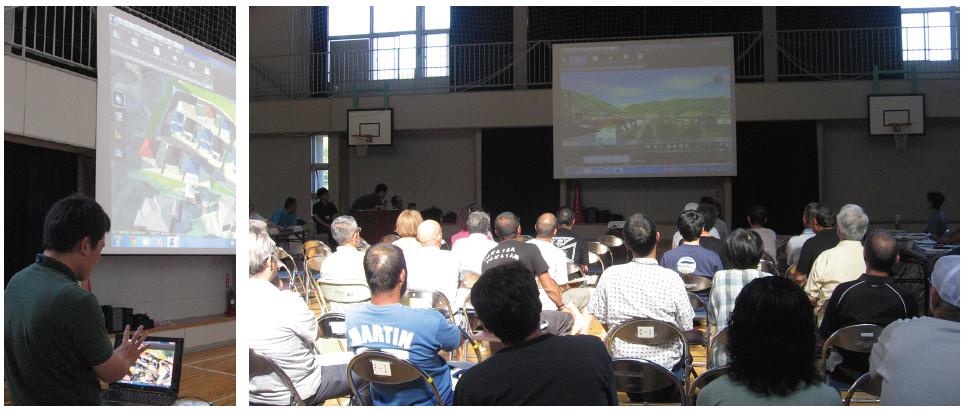 復興計画の住民説明会 3Dモデルが映しだされたスクリーンを熱心に見る住民